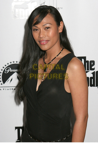 CASSANDRA HEPBURN.Godfather The Game Premiere held at Privilege, West Hollywood, California, USA..March 15th, 2006.Photo: Byron Purvis/AdMedia/Capital Pictures.Ref: BP/ADM.half length black top sleeveless necklace.www.capitalpictures.com.sales@capitalpictures.com.© Capital Pictures.