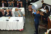 An officer of De Nationale Assemblée (DNA) / The National Assemble of Suriname shows empty vote box to the members.....Desi Bouterse (Desiré Delano Bouterse) chosen as new president of Suriname by De Nationale Assemblée (DNA) / The National Assemble of Suriname. He took 36 votes of 51 as leader of the Mega Combination. ....Robert_Ameerali the head of KKF (Kamer van Koophandel en Fabrieken) / Chamber of Commerce and Industry also selected as Vice President.....Desi Bouterse (Desiré Delano Bouterse) will sworn at 3 August 2010