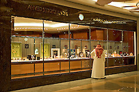 Dubai, United Arab Emirates. Bur Juman shopping mall. Arab man window shopping at jewellery/jewelry store..