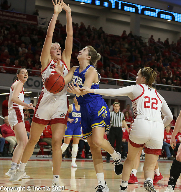 VERMILLION, SD - JANUARY 19: Paiton Burckhard #33 of the South Dakota State Jackrabbits is hacked on the arm by Chloe Lamb #22 of the South Dakota Coyotes while teammate Hannah Sjerven #34 defends at the Sanford Coyote Center on January 19, 2020 in Vermillion, South Dakota. (Photo by Dave Eggen/Inertia)