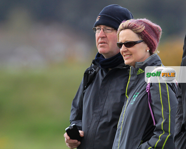Mickey And Brid Moynihan watching their son Gavin Moynihan (The Island) on the 13th green during Round 4 of the Irish Amateur Open Championship at Royal Dublin on Saturday 10th May 2015.<br /> Picture:  Thos Caffrey / www.golffile.ie
