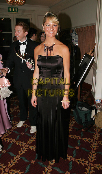 ALEX BEST .The Chocolate Ball in aid of Sargent Cancer Care for Children at the Cafe Royal, Piccadilly.11 March 2004.full length, full-length, long brown strapless dress.www.capitalpictures.com.sales@capitalpictures.com.© Capital Pictures.