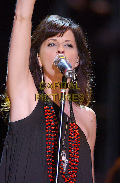 KAREN FAIRCHILD - LITTLE BIG TOWN.2007 CMA Music Festival held at LP Field, Nashville, Tennessee, USA..June 8th, 2007.half length stage concert live gig performance music singing black top armpit arm in air .CAP/ADM/GS.©George Shepherd/AdMedia/Capital Pictures