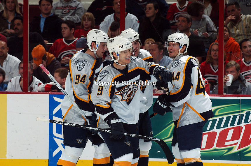 Nashville Predators' Paul Kariya celebrates a goal with teammates Yanic Perreault (94) and Kimmo Timonen (44) of Finland during a game against the Carolina Hurricanes Friday, January 13, 2006 in Raleigh, NC. Carolina won 5-4 after a shootout.