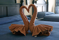 Kissing swans towel origami on the bed in a luxury resort hotel room, Mazatlan, Sinaloa, Mexico