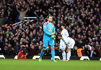 Sunday 07 December 2014<br /> Pictured: Swansea goalkeeper Lukasz Fabianski walks off the pitch after being shown a red card by referee Chris Foy<br /> Re: Premier League West Ham United v Swansea City FC at Boleyn Ground, London, UK.