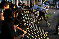 Clashes in Gualajara downtown between policemen and demonstrators against new Mexican President Enrique Peña Nieto, who was searing in at the moment of the clashes