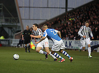 John McGinn ets away from Rowan Vine in the St Mirren v St Johnstone Clydesdale Bank Scottish Premier League match played at St Mirren Park, Paisley on 8.12.12.