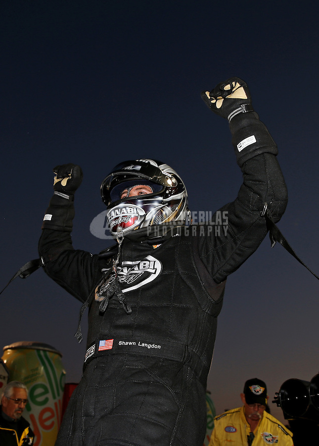 Feb. 17, 2013; Pomona, CA, USA; NHRA top fuel dragster driver Shawn Langdon celebrates after winning during the Winternationals at Auto Club Raceway at Pomona. Mandatory Credit: Mark J. Rebilas-