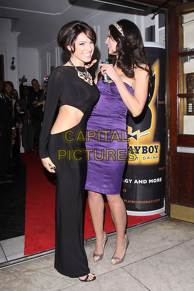 KELLY BROOK & HOPE DWORACZYK.Attending the Playboy Energy Drink UK Launch Party at Funky Buddha, London, England, UK, November 18th 2010..full length purple silk satin bustier dress  peep toe gold shoes christian louboutin heels strapless silver sparkly black long maxi  cut out side .CAP/AH.©Adam Houghton/Capital Pictures.