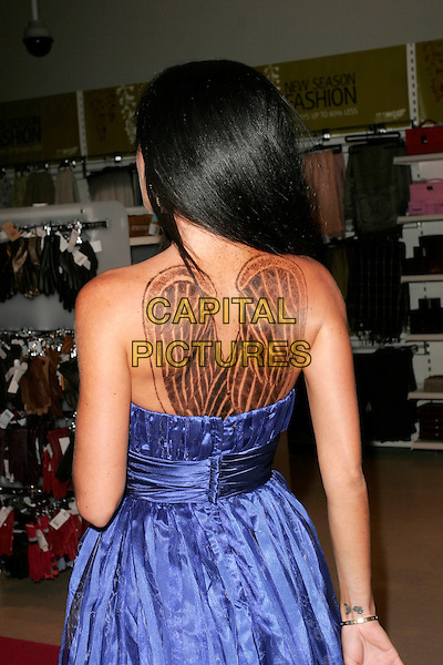 "JASMINE LENNARD .Book Launch Party of ""The Lazy Goddess"", TK Maxx, Kensington High Street, London, England..September 9th, 2008.half length dress purple blue silk satin  tattoo angel wings strapless back behind rear .CAP/AH.©Adam Houghton/Capital Pictures.."