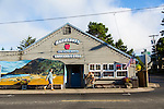 "Manzanita, Oregon, located on Neahkahnie Beach, is a small beach town located in Tillamook County on the Northern Oregon coast.  Manzanita means ""little apple"" in Spanish. Pictured here is the local grocery store which has a mural of Neahkahnie Mountain and the ocean painted on the front of the building."
