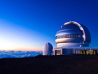 A sunset-lit long-exposure image of the observatories on Mauna Kea, Big Island.