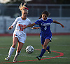 Tierney Harmon #16 of Manhasset, left, and Cailey Rivas #3 of Calhoun battle for possession during a Nassau County Conference AB1 varsity girls soccer game at Calhoun High School on Tuesday, Oct. 16, 2018. The match, which was called with 9:57 remaining due to darkness, ended in a 1-1 tie.