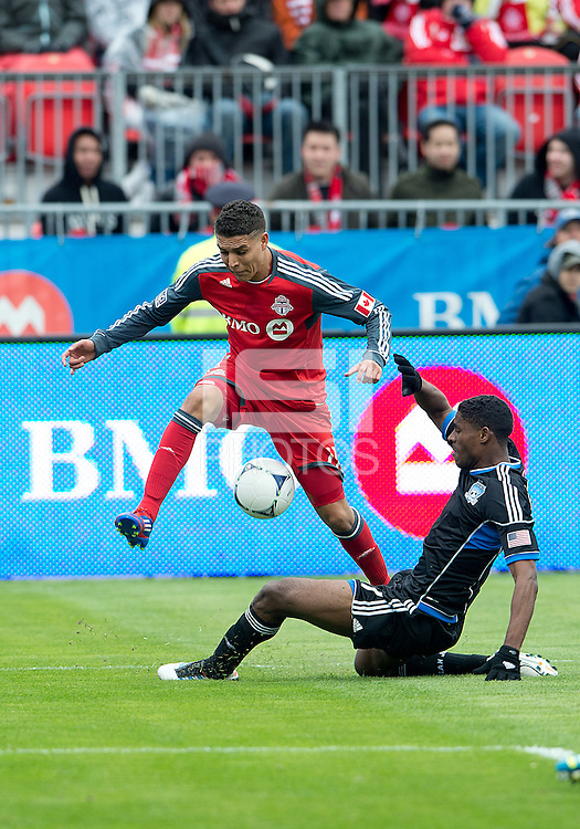 24 March 2012: Toronto FC midfielder Luis Silva #11 and San Jose Earthquakes midfielder Khari Stephenson #7 in action during a game between the San Jose Earthquakes and Toronto FC at BMO Field in Toronto..The San Jose Earthquakes won 3-0..