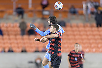 Houston, TX - Friday December 9, 2016: Tucker Hume (36) of the North Carolina Tar Heels wins a header over Tomas Hilliard-Arce (4) of the Stanford Cardinal at the NCAA Men's Soccer Semifinals at BBVA Compass Stadium in Houston Texas.