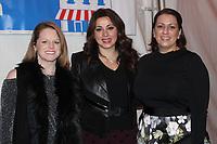 NWA Democrat-Gazette/CARIN SCHOPPMEYER Marlena Bonds (from left) Silvia Azrai-Kawas and Venessa Yates visit at Christmas at the Mansion.