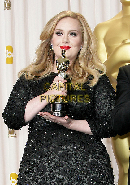 Adele (Adele Laurie Blue Adkins)  .85th Annual Academy Awards held at the Dolby Theatre at Hollywood & Highland Center, Hollywood, California, USA..February 24th, 2013.pressroom oscars half length black  beads beaded dress award trophy winner red lipstick .CAP/ADM.©AdMedia/Capital Pictures.
