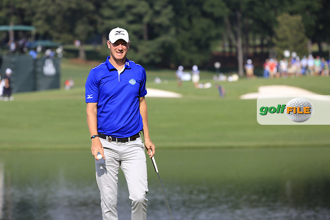 Chris Wood (ENG) sinks his putt on the 14th green during Thursday's Round 1 of the 2017 PGA Championship held at Quail Hollow Golf Club, Charlotte, North Carolina, USA. 10th August 2017.<br /> Picture: Eoin Clarke | Golffile<br /> <br /> <br /> All photos usage must carry mandatory copyright credit (&copy; Golffile | Eoin Clarke)