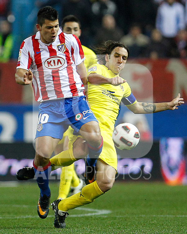 Atletico de Madrid's Kun Aguero (l) and Villareal's Gonzalo Rodriguez during La Liga match.March 5,2011. (ALTERPHOTOS/Acero)