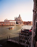 ITALY, Venice, people traveling on water taxi with St. Mary's Basilica in the background