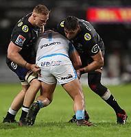 DURBAN, SOUTH AFRICA - APRIL 14: Jean-Luc du Preez of the Cell C Sharks and Ruan Botha (captain) of the Cell C Sharks tackling Pierre Schoeman of the Vodacom Blue Bulls during the Super Rugby match between Cell C Sharks and Vodacom Bulls at Jonsson Kings Park Stadium on April 14, 2018 in Durban, South Africa. Photo: Steve Haag / stevehaagsports.com