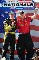 Sept. 6, 2010; Clermont, IN, USA; NHRA top fuel dragster driver Morgan Lucas (left) with David Grubnic during driver introductions prior to the U.S. Nationals at O'Reilly Raceway Park at Indianapolis. Mandatory Credit: Mark J. Rebilas-