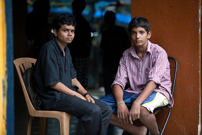 Railway Children Program   12 September 2011, Mumbai, INDIA: Staff member Joseph Pinto talks with 15 year old Shobbit at the Don Bosco shelter in Mumbai. Pinto, himself  a former Don Bosco resident, is from Balprafulta, a local NGO  that identifies and rescues children from around the railway stations of Mumbai and assisits them into getting accomodation and education at the Don Bosco shelter funded by British Comic Relief..Picture by Graham Crouch/Comic Relief