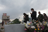 People pray at a memorial to victims of the 2011 Tsunami in Hiyoriyama Park in Natori, near Sendai, Miyagi, Japan. Friday March 11th 2016. 2016 marks the fifth anniversary of the Great East Japan earthquake. This magnitude 9 quake caused a tsunami that flattened large parts of the Tohoku coast killing around 18,000 people and caused a nuclear disaster at Fukushima Daichi Power Station.