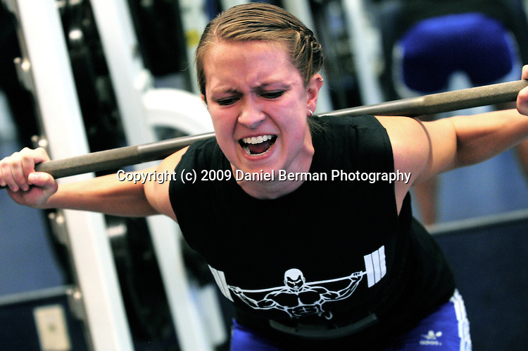 Sarah Moorman screams as she squat lifts 145 pounds in the WWU Strongman Club weightlifting competition Saturday November 21, 2009 at the Wade King Recreational Center. The competition featured squat, bench press, and deadlifts. Photo by Daniel Berman/www.bermanphotos.com