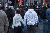 """Etwa 2.000 rechtsradikale Menschen demonstrierten am Samstag den 12. Maerz 2016 in Berlin unter dem Motto """"Merkel muss weg!"""" gegen Angela Merkel, gegen Fluechtlinge und fuer """"Das deutsche Vaterland"""".<br /> Bis auf wenige Ausnahmen waren angereisten Teilnehmer Neonazis und Hooligans, NPD-, Pediga- und AfD-Mitglieder.<br /> Aufgerufen zu dem Aufmarsch hatten die Hooligan-Gruppen """"Buendnis fuer Deutschland"""" und """"Buendnis fuer Berlin"""".<br /> Im Bild: Aufmarschteilnehmer tragen Jacken mit der englischen Aufschrift """"German Patriot"""" unter der eine Fahne in den Farben des Deutschen Reiches abgebildet ist.<br /> 12.3.2016, Berlin<br /> Copyright: Christian-Ditsch.de<br /> [Inhaltsveraendernde Manipulation des Fotos nur nach ausdruecklicher Genehmigung des Fotografen. Vereinbarungen ueber Abtretung von Persoenlichkeitsrechten/Model Release der abgebildeten Person/Personen liegen nicht vor. NO MODEL RELEASE! Nur fuer Redaktionelle Zwecke. Don't publish without copyright Christian-Ditsch.de, Veroeffentlichung nur mit Fotografennennung, sowie gegen Honorar, MwSt. und Beleg. Konto: I N G - D i B a, IBAN DE58500105175400192269, BIC INGDDEFFXXX, Kontakt: post@christian-ditsch.de<br /> Bei der Bearbeitung der Dateiinformationen darf die Urheberkennzeichnung in den EXIF- und  IPTC-Daten nicht entfernt werden, diese sind in digitalen Medien nach §95c UrhG rechtlich geschuetzt. Der Urhebervermerk wird gemaess §13 UrhG verlangt.]"""