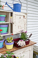 63821-201.14 Potting bench with containers and flowers in spring, Marion Co. IL