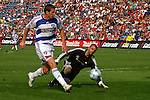 Kenny Cooper of FC Dallas puts one past Jon Busch of the Chicago Fire for a goal