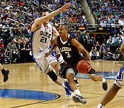 C.J. McCollum drives the ball past Miles Plumlee for a layup, scoring 2 of his 30 total points. Lehigh defeated Duke 75-70 during the 2nd round of the 2012 NCAA Basketball Championship at the Greensboro Coliseum in Greensboro, NC. Photo by Al Drago.