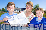 NEWS: Helen Bartle (centre) with the new 'Roundabout Raheen' newsletter she has published for the local community with her children Megan and Tom O'Rourke.