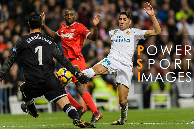 Achraf Hakimi of Real Madrid (R) attempts a kick while being defended by Goalkeeper Sergio Rico of Sevilla FC (L) during La Liga 2017-18 match between Real Madrid and Sevilla FC at Santiago Bernabeu Stadium on 09 December 2017 in Madrid, Spain. Photo by Diego Souto / Power Sport Images