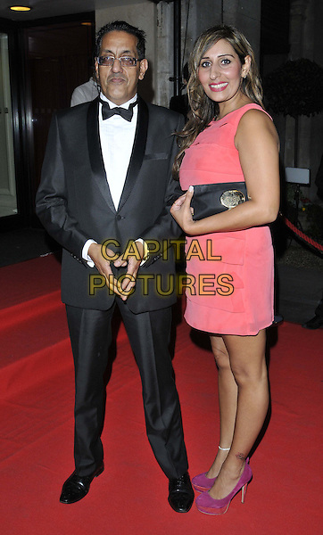 LONDON, ENGLAND - SEPTEMBER 19: Nazir Afsal &amp; guest attend the Asian Achievers Awards 2014, Grosvenor House Hotel, Park Lane, on Friday September 19, 2014 in London, England, UK. <br /> CAP/CAN<br /> &copy;Can Nguyen/Capital Pictures