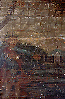 A detail of a fresco, depicting a man pointing to the outline of a ship. that has faded over time and through neglect