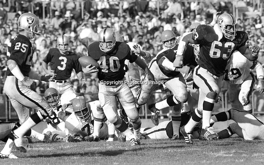 Oakland Raiders on attack against the Cincinnati Bengals.., Fred Biletnikoff, Daryle Lamonica, runner Pete Banazak, and guard Gene Upshaw. (1969 photo by Ron Riesterer)