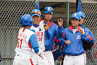 14 September 2009: Shortstop Boung-Gon Jeung of South Korea is congratulated by his teammates during the 2009 Baseball World Cup Group F second round match game won 15-5 by South Korea over Great Britain, in the Dutch city of Amsterdan, Netherlands.