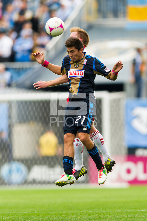 Michael Farfan (21) of the Philadelphia Union goes up for a header with Dax McCarty (11) of the New York Red Bulls during a Major League Soccer (MLS) match at PPL Park in Chester, PA, on October 27, 2012.