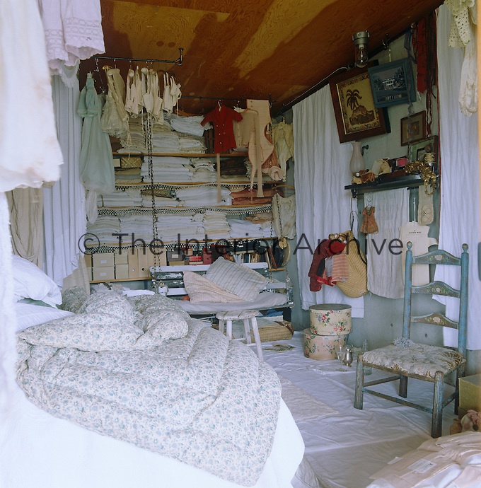 An extensive collection of antique linens and Depression-era clothes are stored and displayed in the bedroom