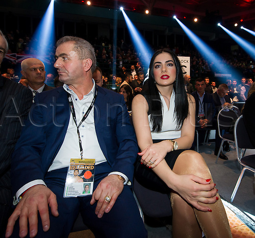 27.02.2016. Halle, Germany.  Amina Huck (R), wife of Marco Huck, sits by the ring ahead of the cruiserweight boxing match between Marco Huck (Germany) and Ola Afolabi (Great Britain) during the at the IBO World Championships in Halle, Germany, 27 February 2016. Marco Huck won in the 10th round.