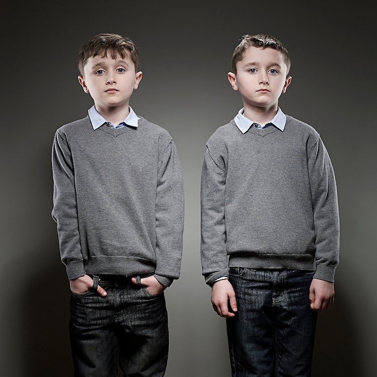 &copy; John Angerson<br /> 140219 - Ethan and Kai Thompson.<br /> They both had leukemia when they were younger. Shot at their home in Birmingham<br /> UK.