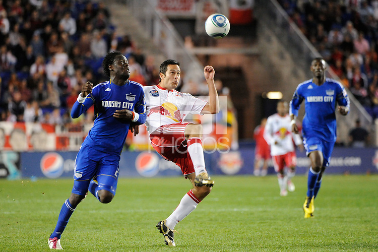 Mike Petke (12) of the New York Red Bulls plays the ball away from Kei Kamara (23) of the Kansas City Wizards. The New York Red Bulls defeated the Kansas City Wizards 1-0 during a Major League Soccer (MLS) match at Red Bull Arena in Harrison, NJ, on October 02, 2010.