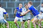 Laune Rangers Peter Crowley is tackled by Kerins O'Rahillys Tommy Walsh and Barry John Keane during their Senior Club Championship semi final clash in Fitzgerald Stadium on Saturday