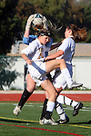 Manhattan Beach, CA 01/25/10 - Palos Verdes goalie Dana Connors (Palos Verdes #1) secures the ball from a challenge by Mira Costa's Kimby Keever (Mira Costa #24).