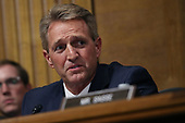 WASHINGTON, DC - SEPTEMBER 27:  Senate Judiciary Committee member Sen. Jeff Flake (R-AZ) questions Judge Brett Kavanaugh during his Supreme Court confirmation hearing in the Dirksen Senate Office Building on Capitol Hill September 27, 2018 in Washington, DC. Kavanaugh was called back to testify about claims by Christine Blasey Ford, who has accused him of sexually assaulting her during a party in 1982 when they were high school students in suburban Maryland.  (Photo by Win McNamee/Getty Images)