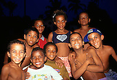 "Bahia State, Brazil. Street children; group of children from about six to thirteen years old, one with ""I Love Bahia"" t-shirt."
