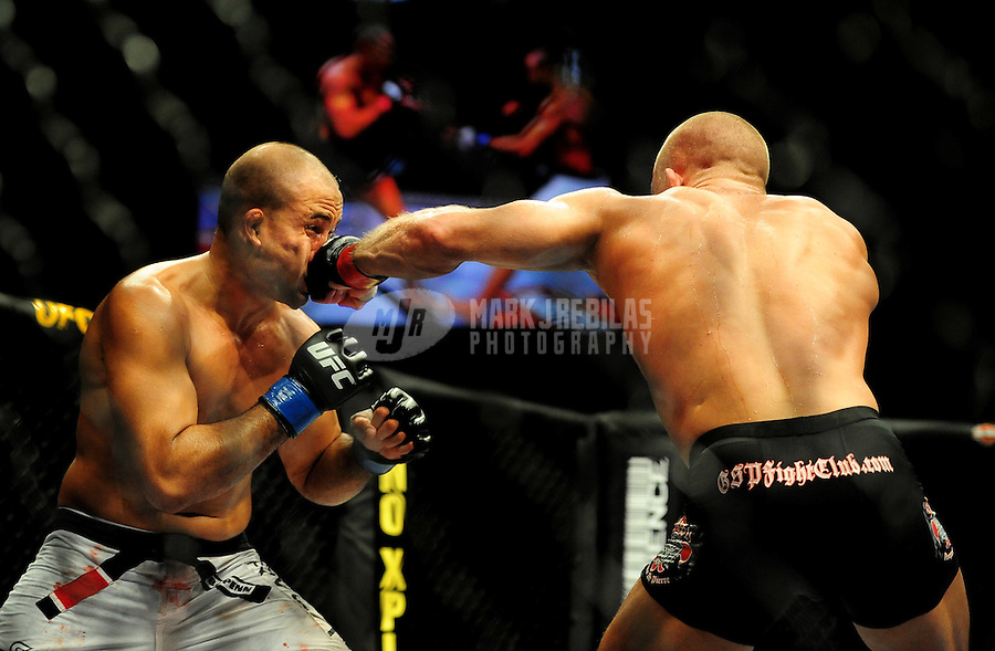 Jan. 31, 2009; Las Vegas, NV, USA; UFC fighter B.J. Penn (white trunks) is punched in the face by Georges St-Pierre (black trunks) during the welterweight championship in UFC 94 at the MGM Grand Hotel and Casino. St-Pierre defeated Penn with a fourth round TKO. Mandatory Credit: Mark J. Rebilas-